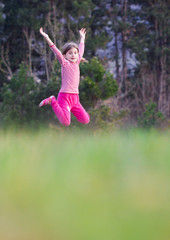 Young girl jumping outdoors
