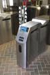 Modern subway ticket turnstile in stainless steel