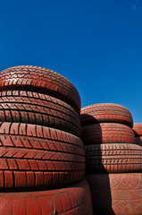 close up of racetrack fence of  red old tires