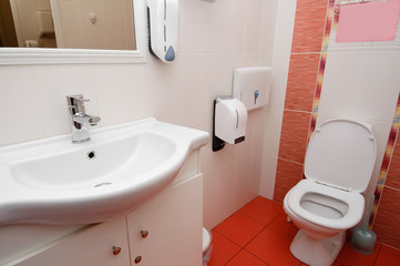 modern toilet interior in white and red colors