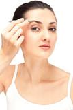 girl pulls eyebrow tweezers poster