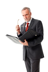 Tough senior business man with folder, isolated