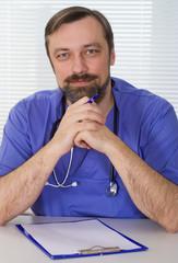 happy doctor sitting