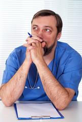 Handsome doctor sitting
