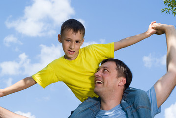 smiling father playing with son