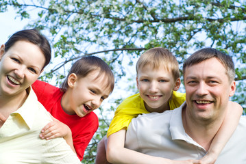 happy famaly on the nature of four