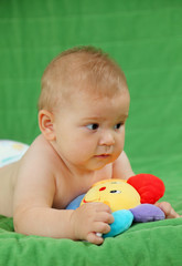 Cute baby girl playing with colorful toy