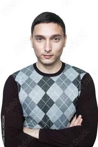 Young man in black checkered sweater with crossed arms