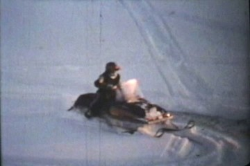 Snowmobiles Doing Spins (1975 Vintage 8mm film)