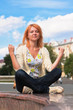 Meditating young ginger-haired woman