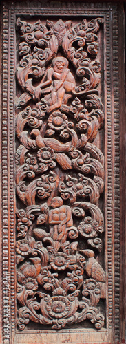 Decorated wooden beside door