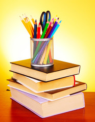 Stationery and books  on red background