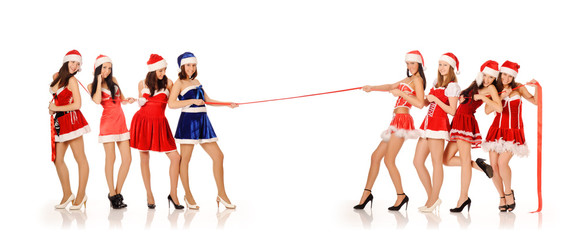 Girls in Santa Claus costumes