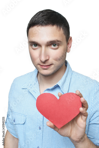 Young man in shirt holding red heart shape isolated on white