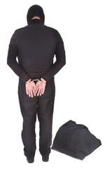 thief with sack handcuffed