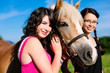 Teenage girls with horse