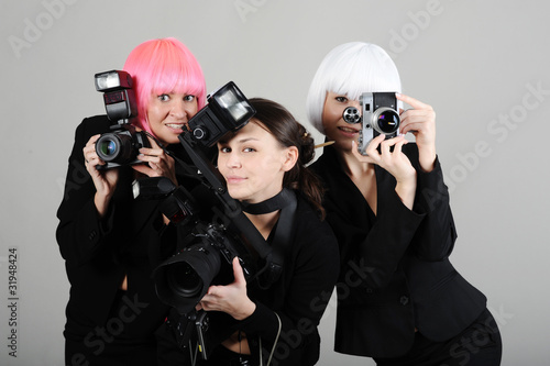 three girls with cameras