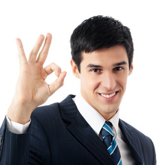 Portrait of happy gesturing young business man, isolated