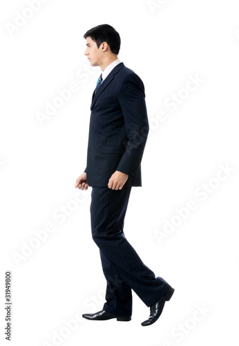 Full body portrait of walking business man, isolated on white