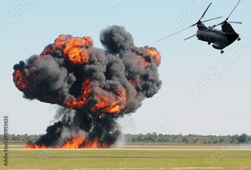 Foto op Canvas Helicopter Helicopter over fire