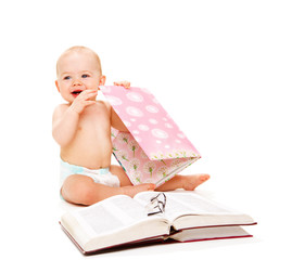 Laughing baby with books