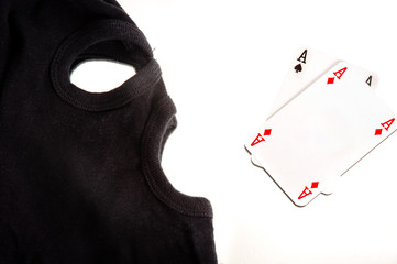 A pair of aces with a mask of a burglar