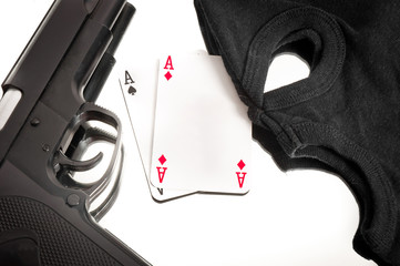 Pistol and mask of a corrup poker player
