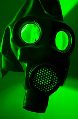 A military gasmask in green light