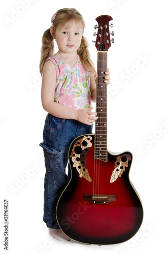 Little girl with an electric guitar