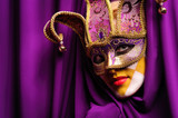 woman in violet mask