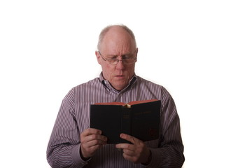 Older Man in Striped Shirt and Glasses Reading Bible