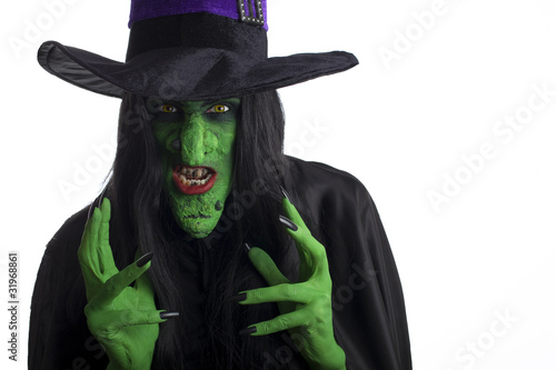 Poster Evil witch looking to attack. White background.