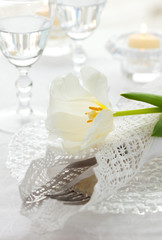 place-setting with white tulip and napkin