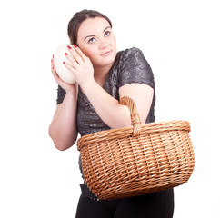 young fat woman with ostriches egg and wicker basket