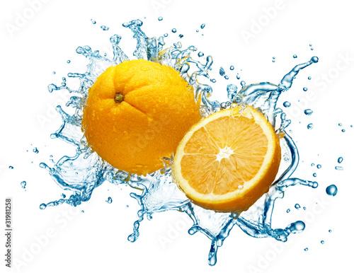 orange in spray of water.