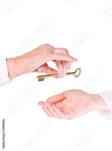 Old woman giving a key to a younger one
