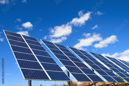 solar panels over blue sky - 31982864