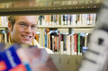 Young Man In A Library