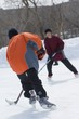 Boys Playing Ice Hockey On An Outdoor Rink