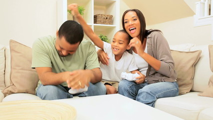 African-American Family Playing on Games Console