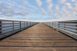 Wooden pier with handrails poster