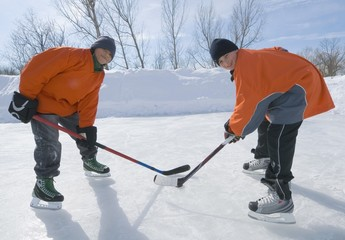 Boy Ice Hockey Players Facing Off