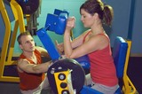 Two People At Gym Working Out