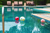 Three beautiful colored balls in the pool poster