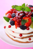 Summer cake with fresh berries and cream