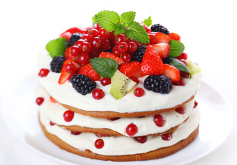 cake with fresh berries isolated on white background