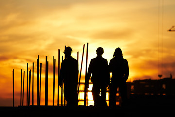 Builders at Sunset