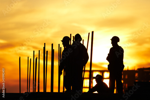 hard workers at sunset