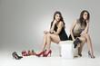 two glamorous women trying high heels