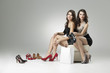 two women trying high heels
